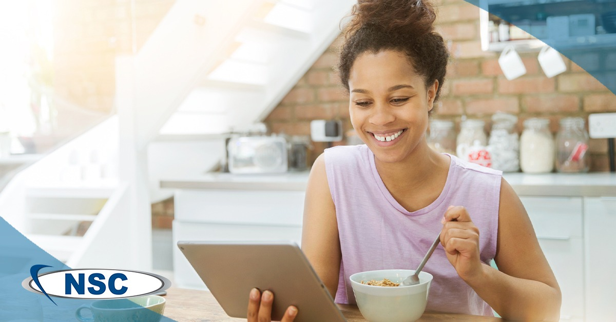 Woman Smiling and Eating Breakfast