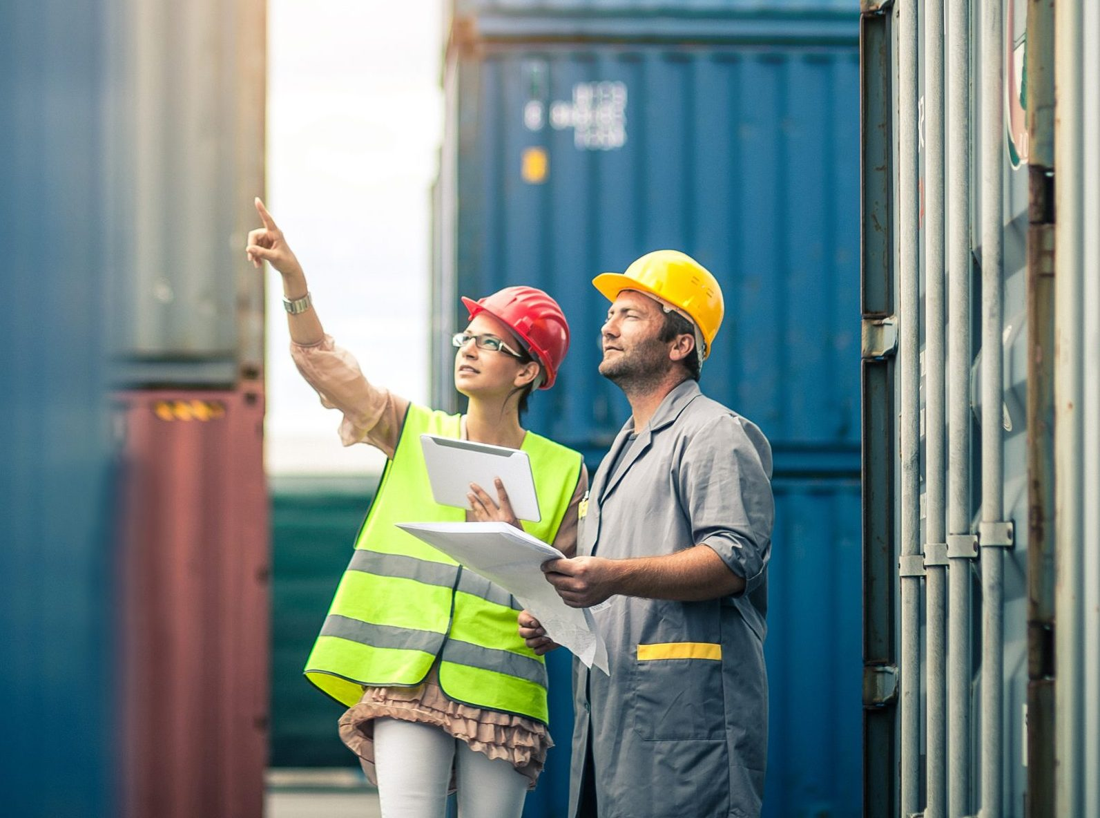 Two workers pointing at cargo