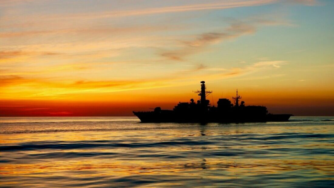 Sunset image of a ship on water