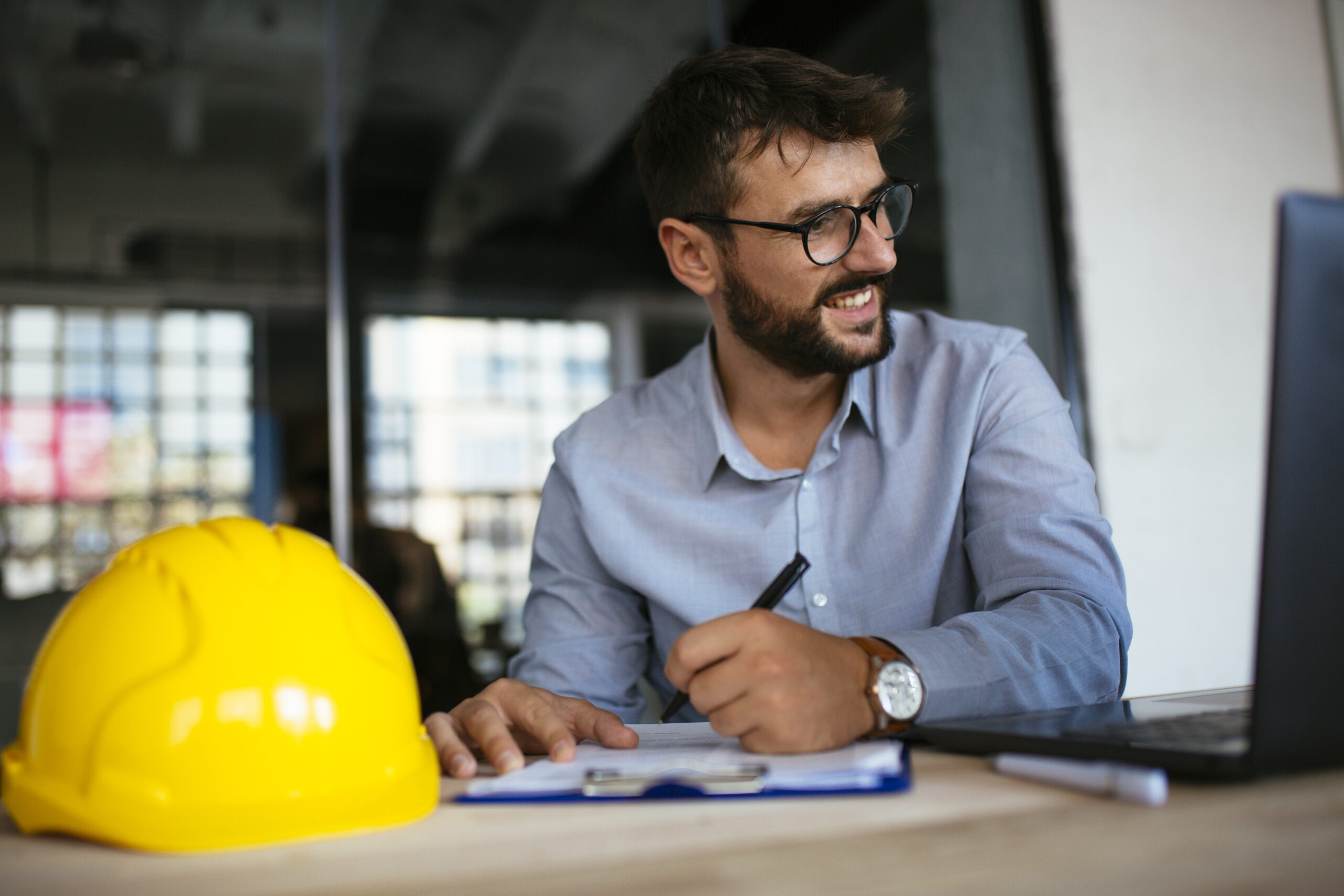 Photo of architect sketching at office
